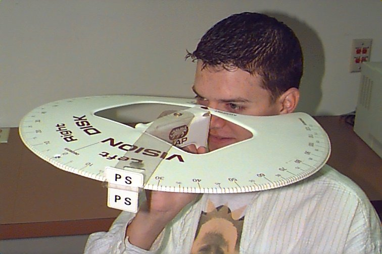 Guy with peripheral vision testing tool